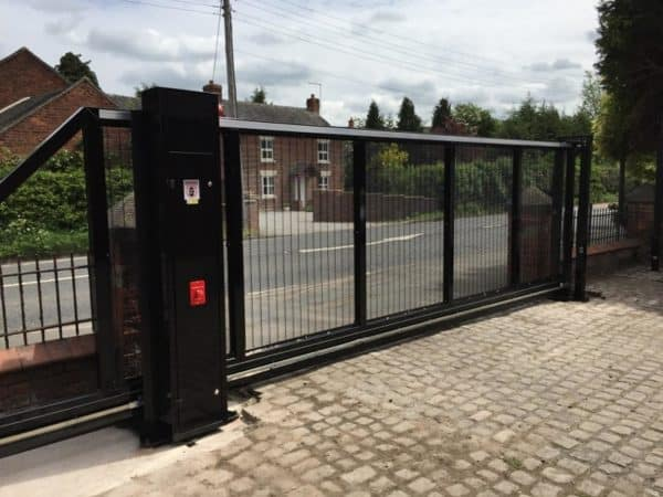 Heavy duty sliding vehicle access gate