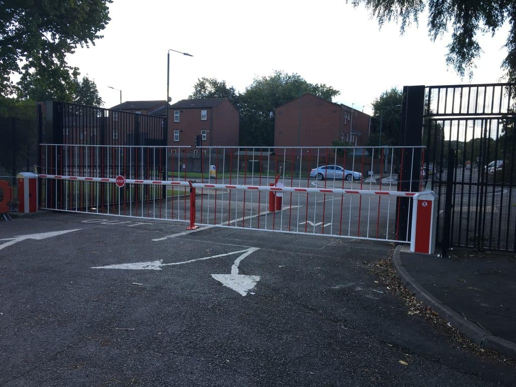 Automated vehicle access barrier and security fencing